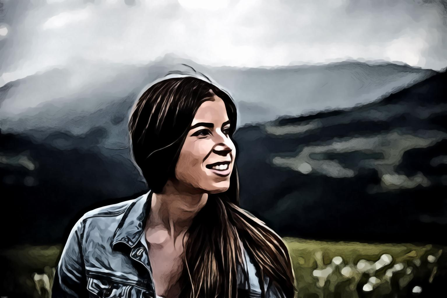 Smiling Woman With Mountains On Background