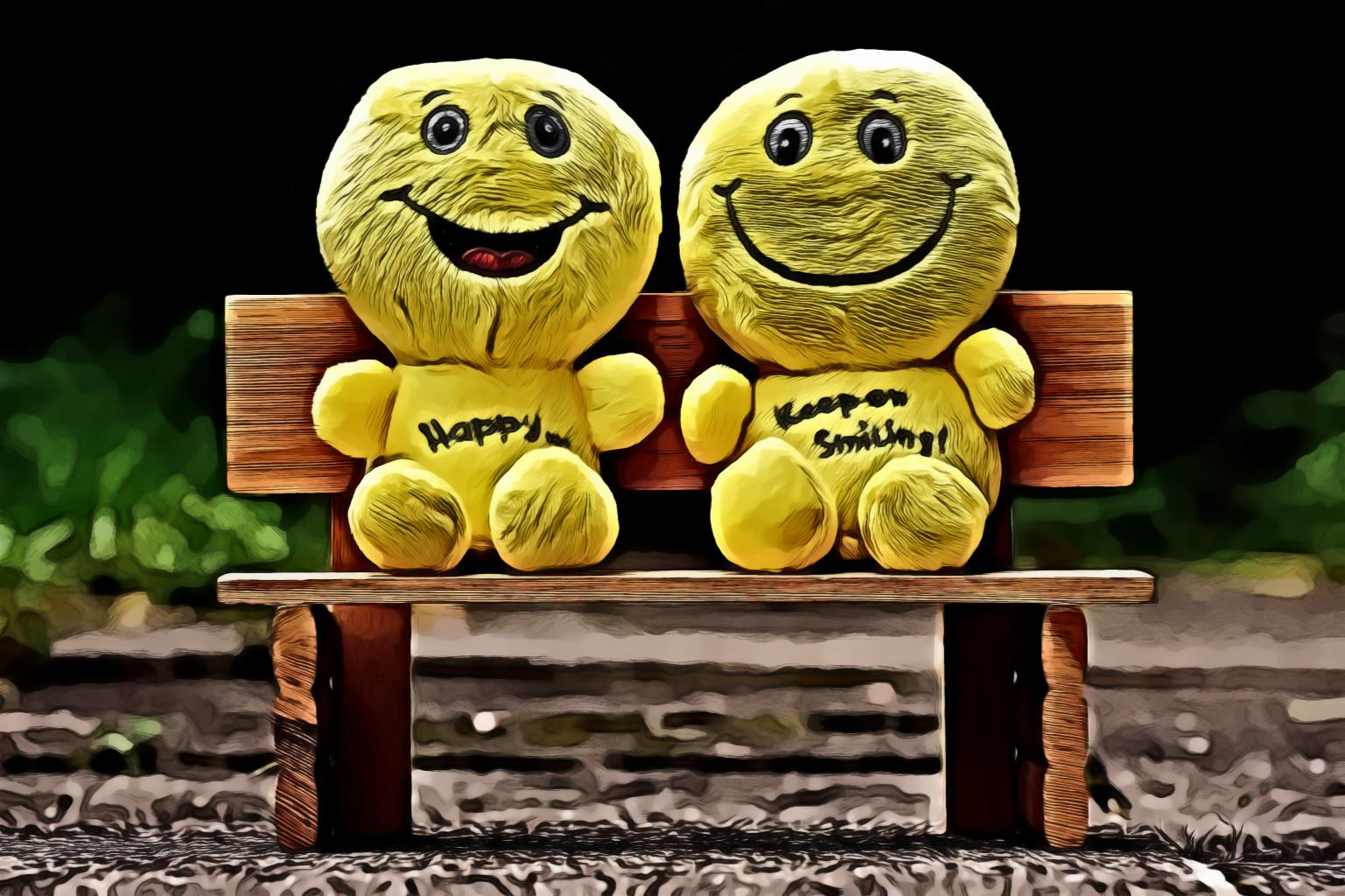 Two Yellow Plush Toys Sitting On Bench
