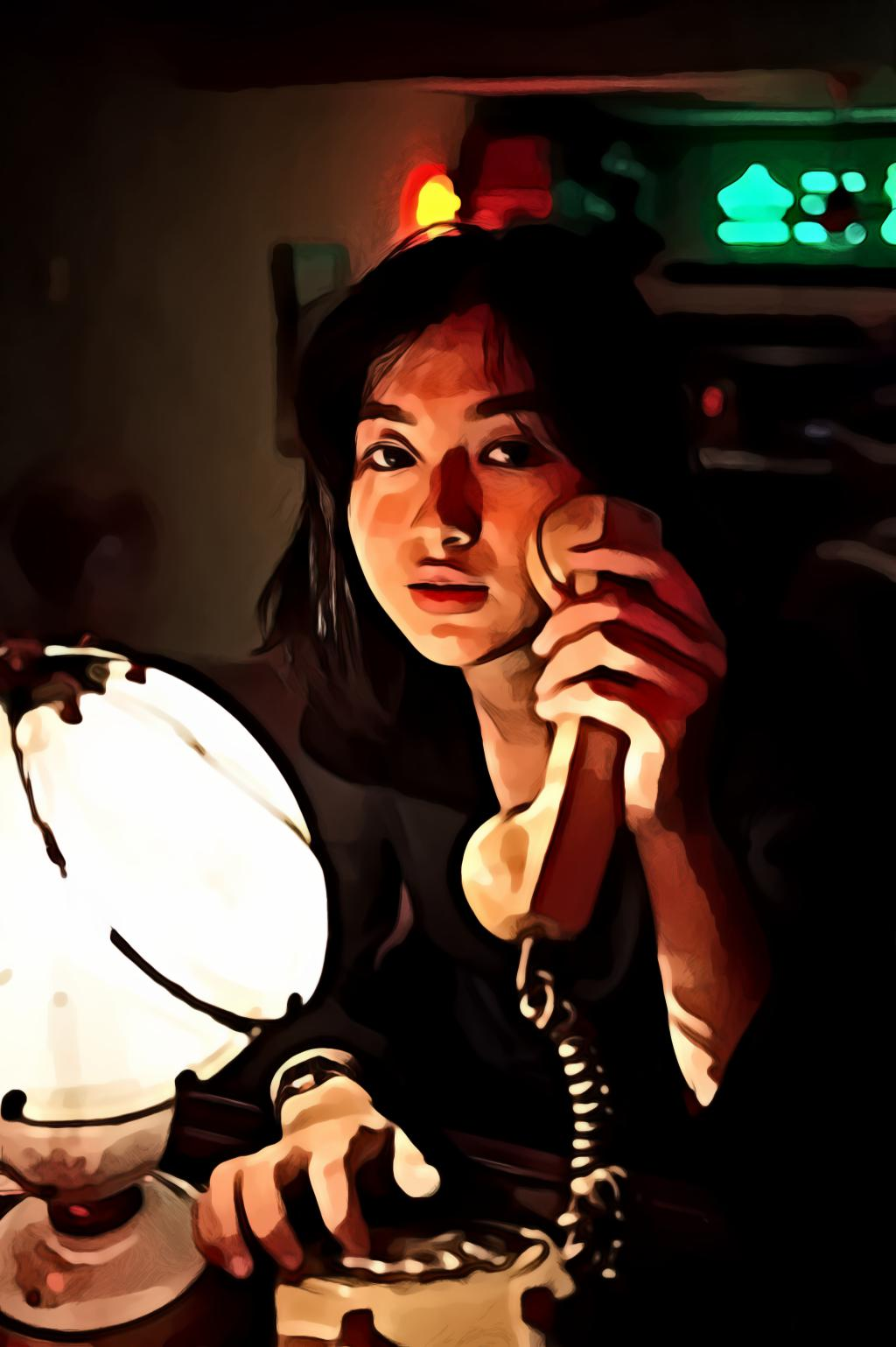 Close-Up Portrait of Woman Holding Telephone