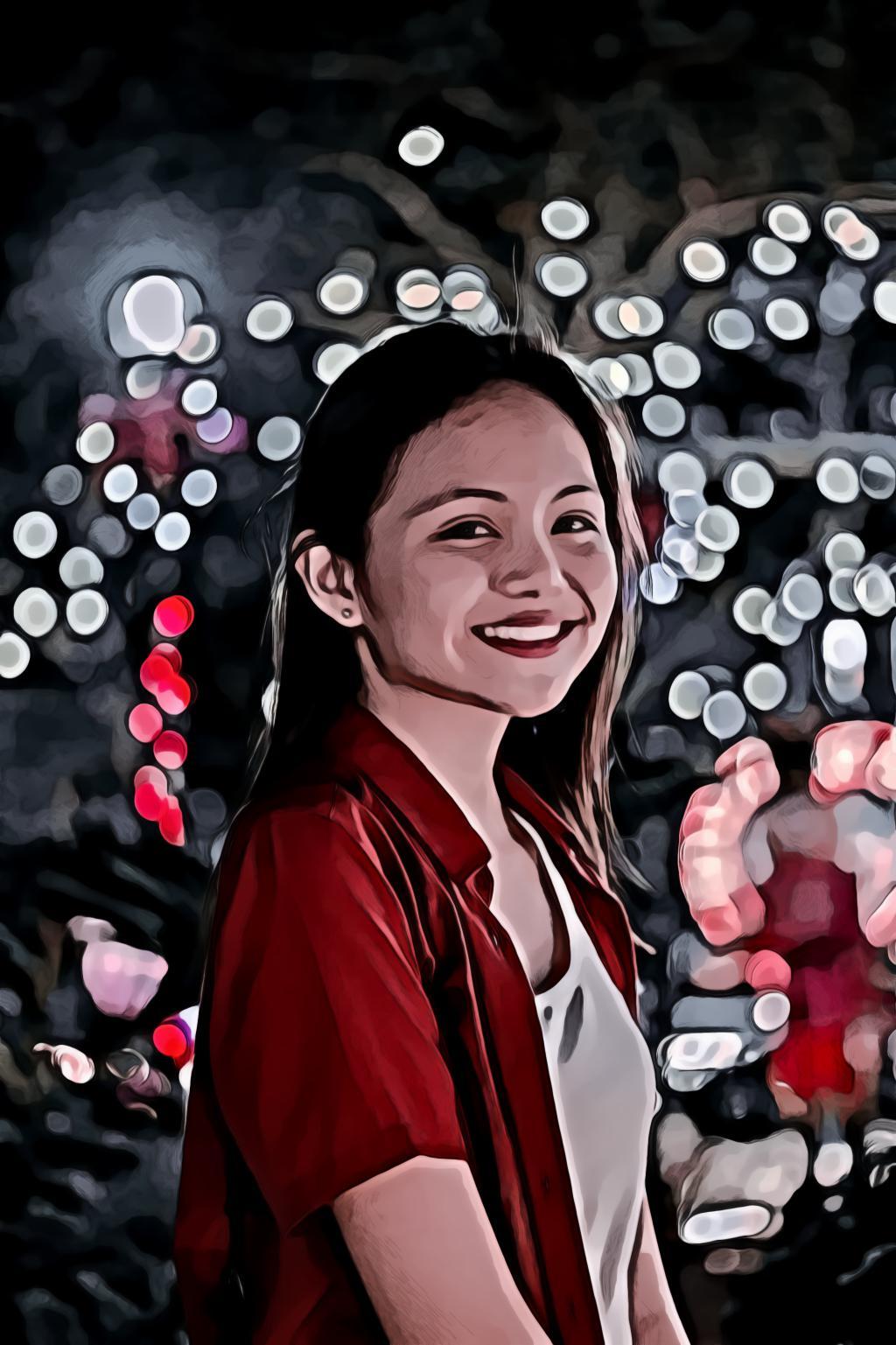 Young Asian Girl Wearing Red Shirt Smiling