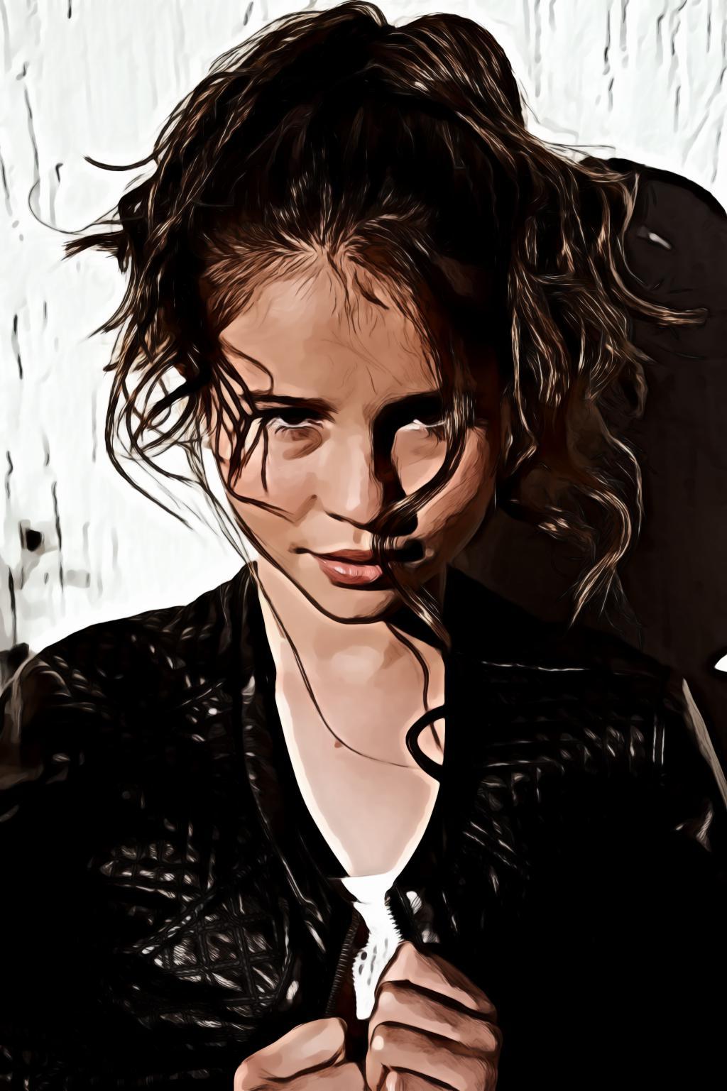 Girl wearing black leather zip jacket