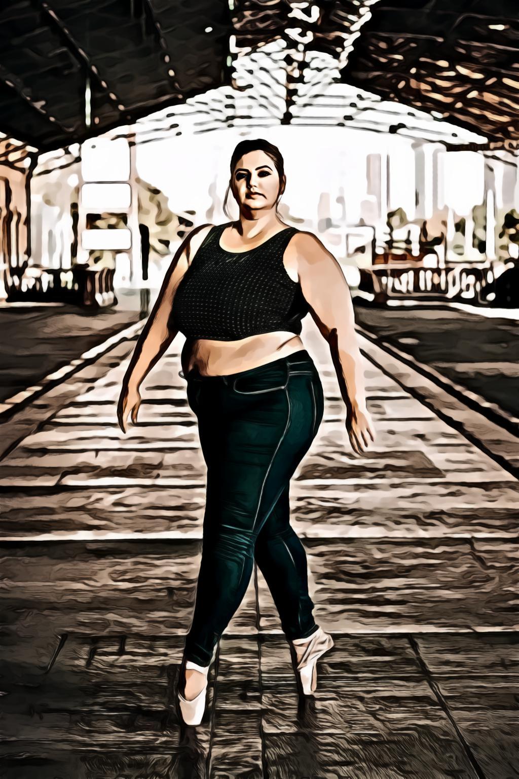 Portrait of woman doing tiptoe