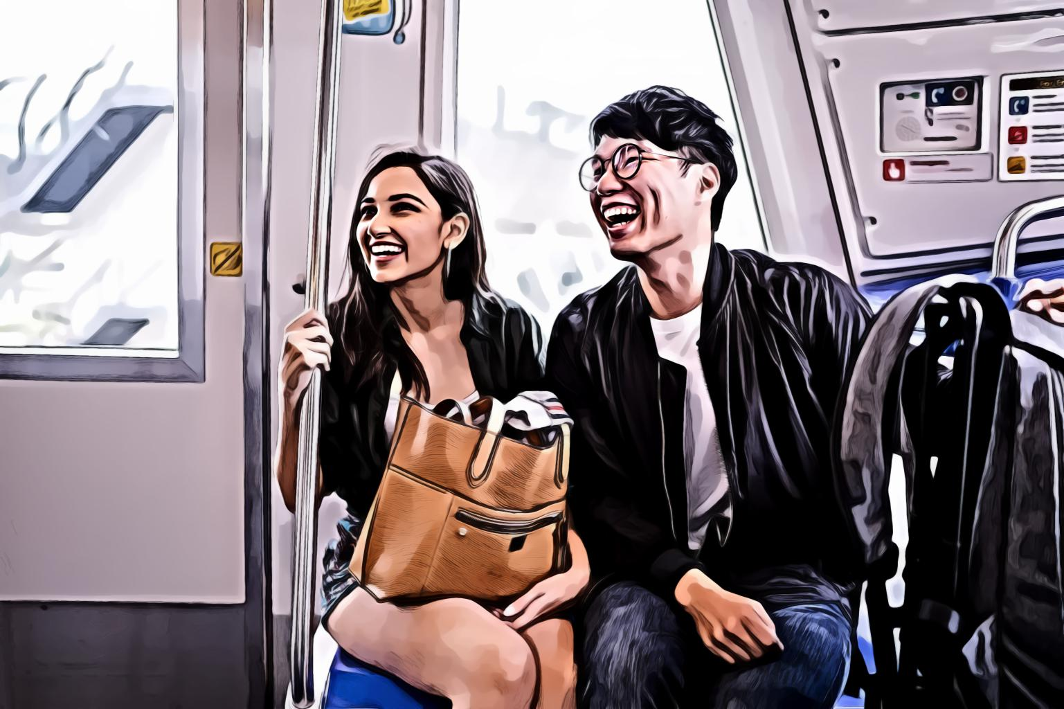 Smiling woman and man inside train