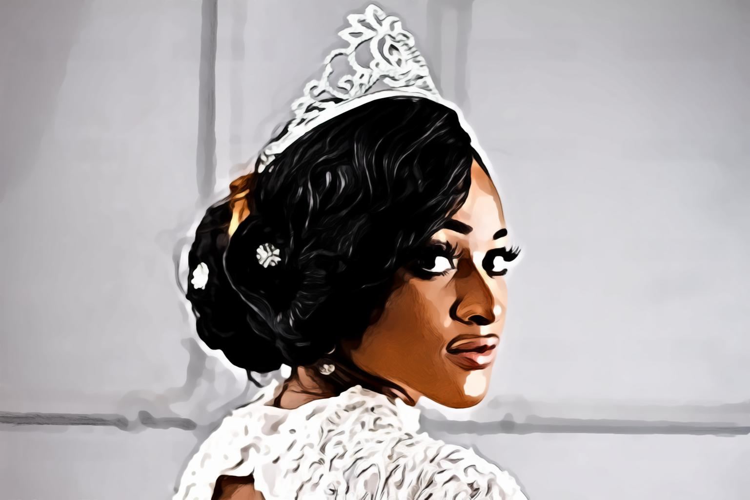 Woman in silver colored crown looking right side