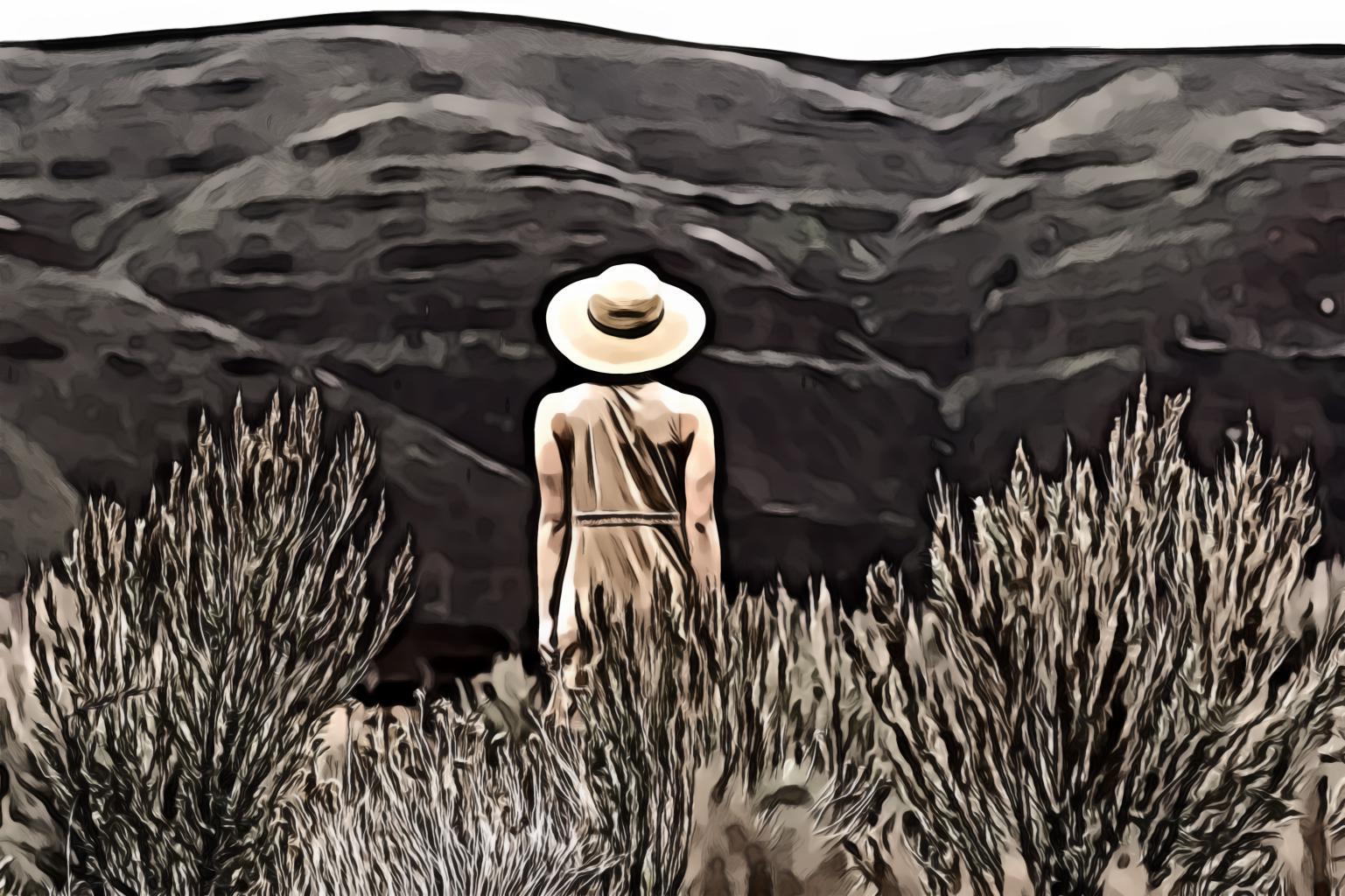 Woman walking on grassfield