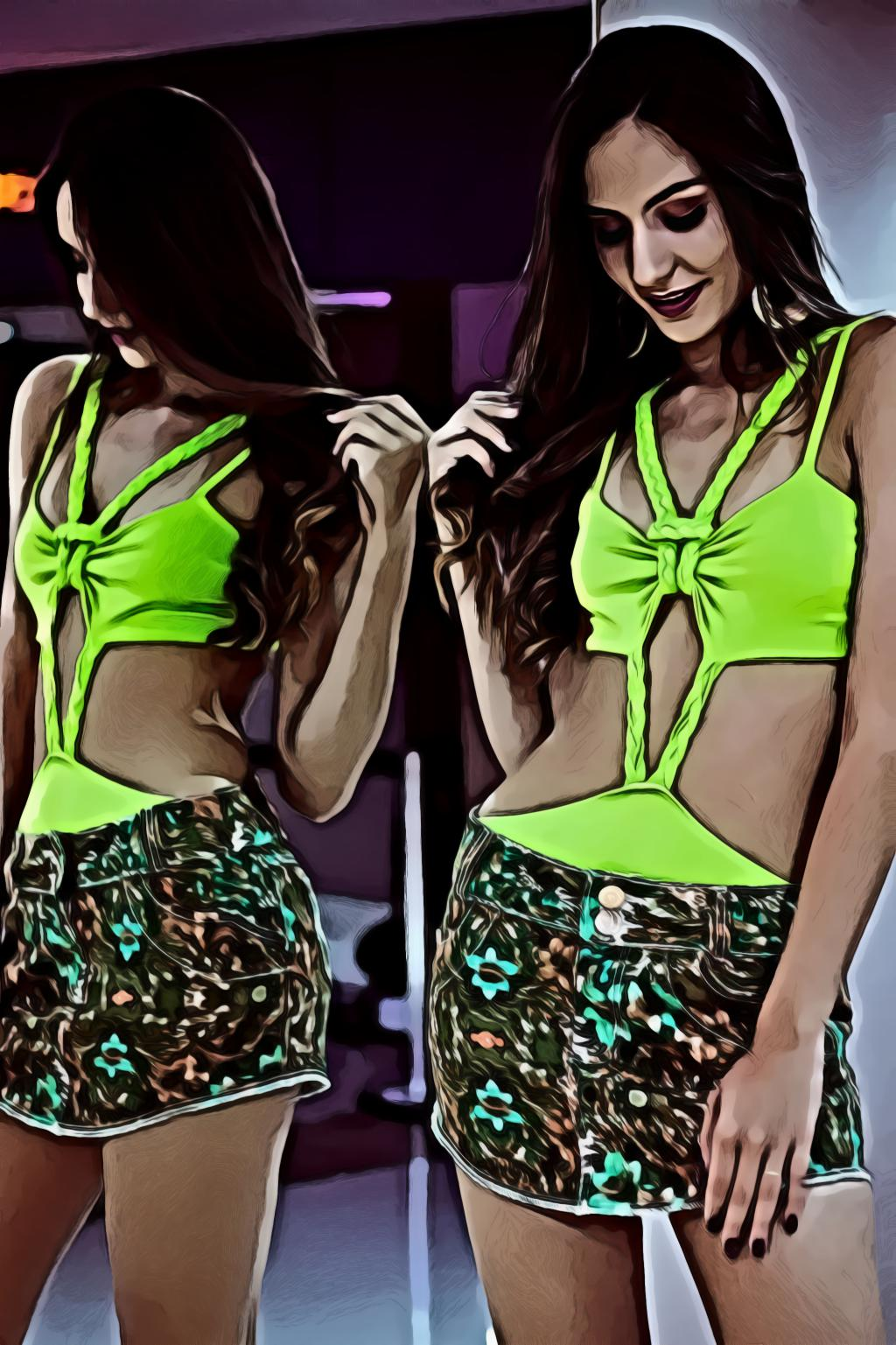 Woman wearing green sleeveless mini dress near the mirror