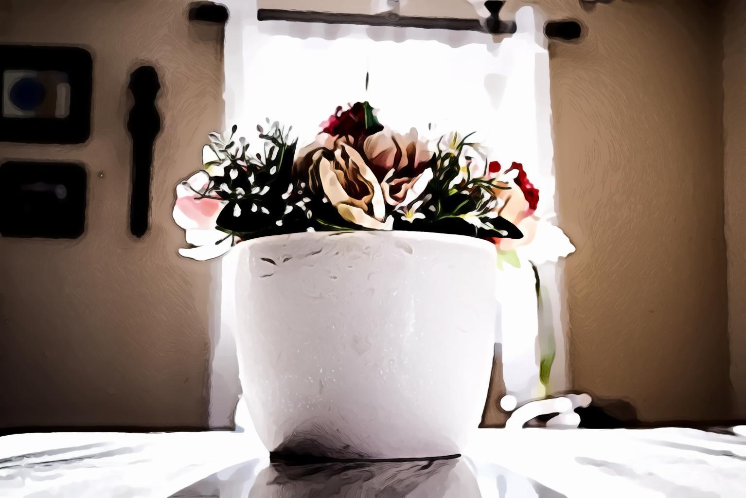 Assorted flowers in white ceramic vase