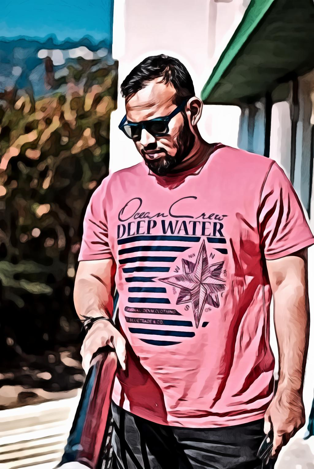 Man in red crew neck t shirt wearing sunglasses