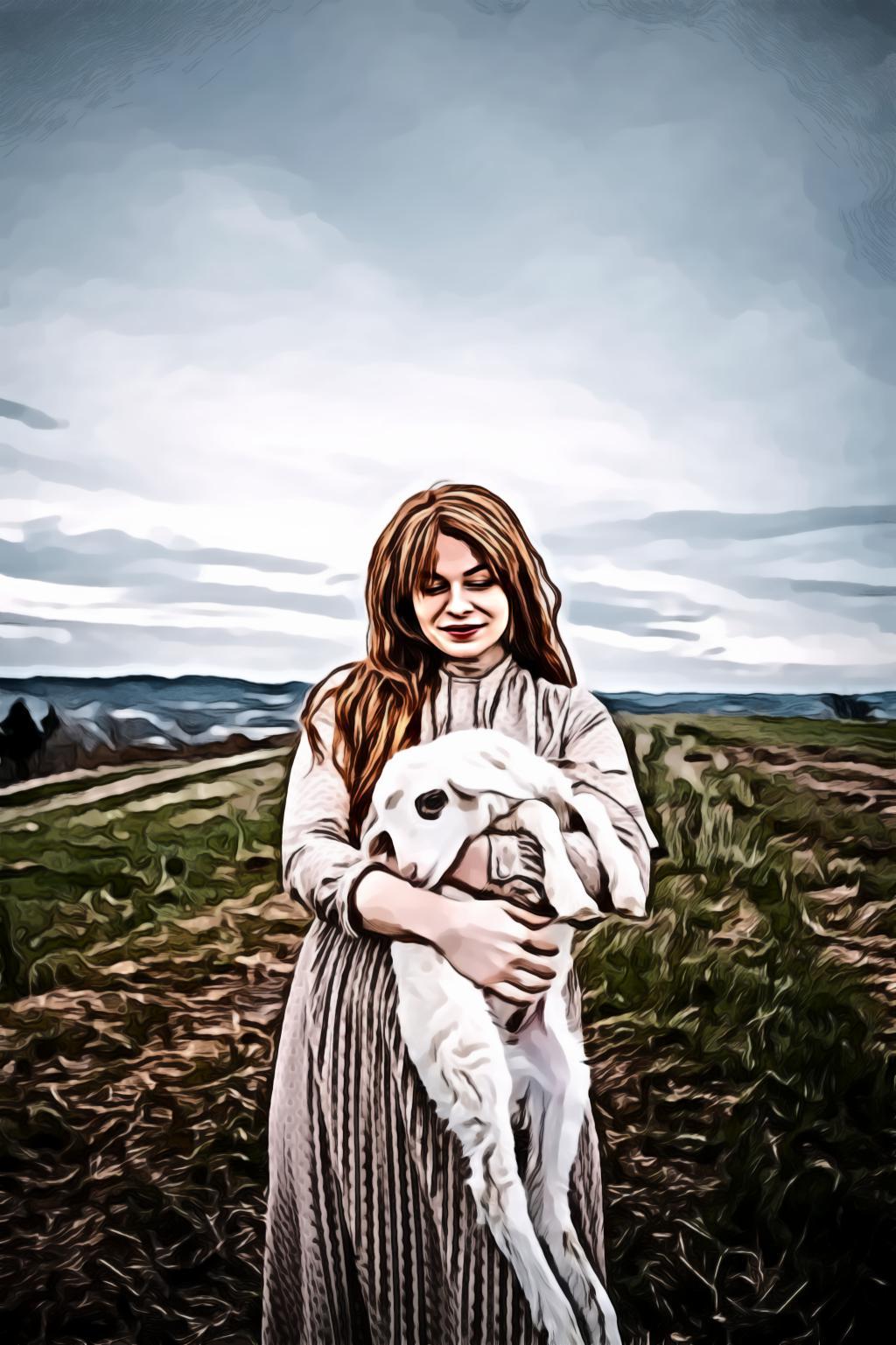 Woman carrying a lamb