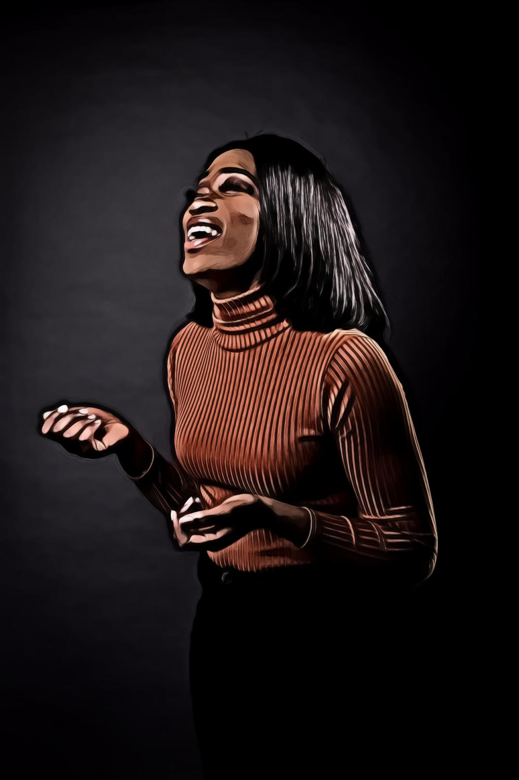 Woman in brown sweater laughing