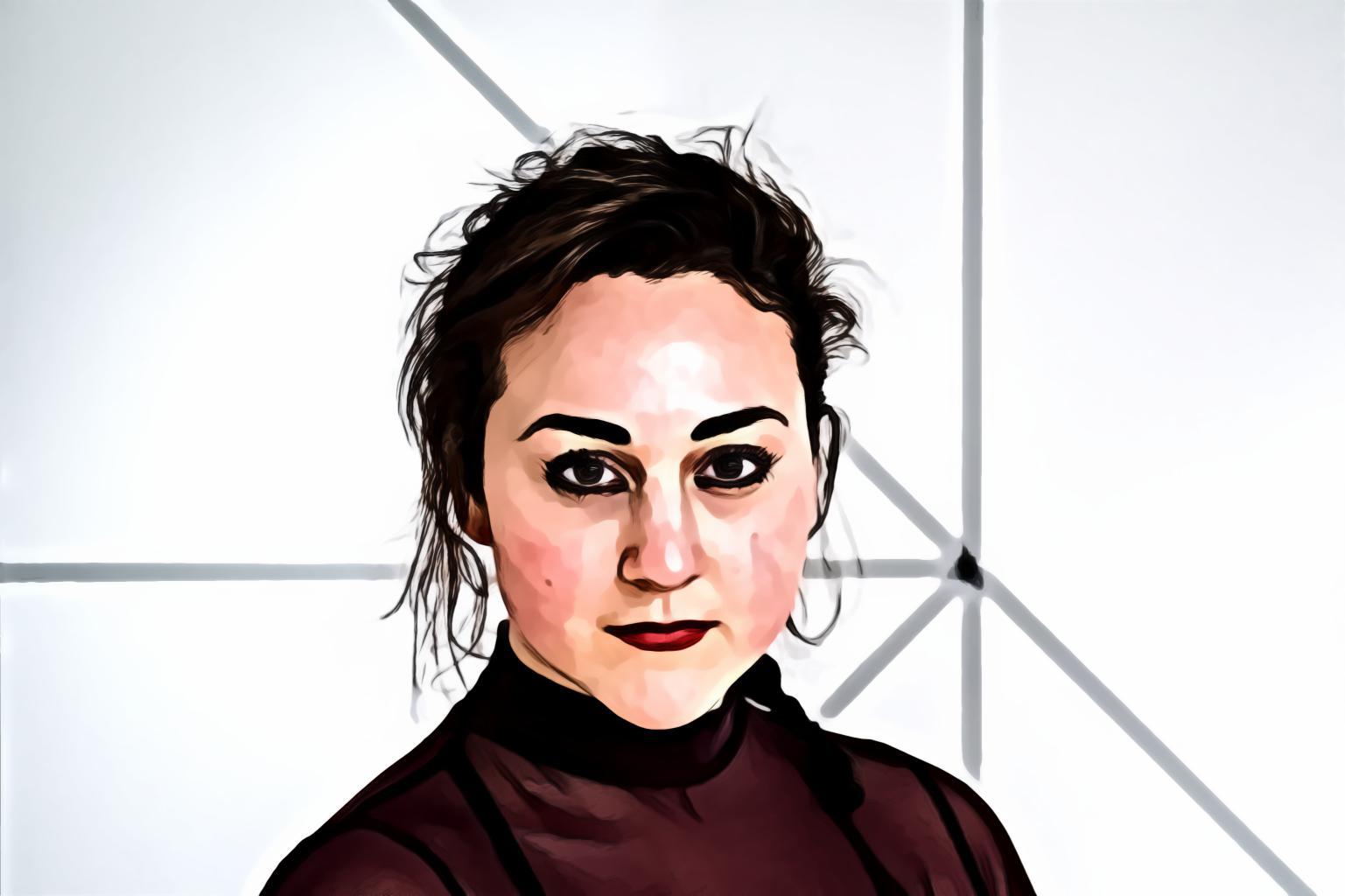 Woman in maroon turtleneck shirt