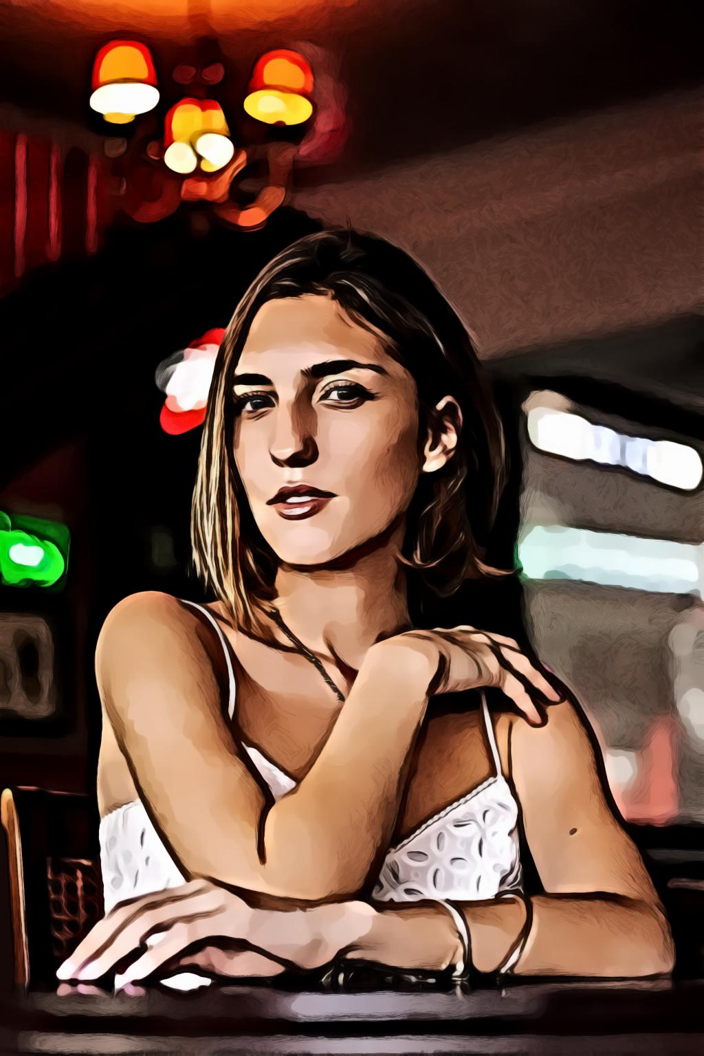 Woman wearing white spaghetti strap top siting by the table