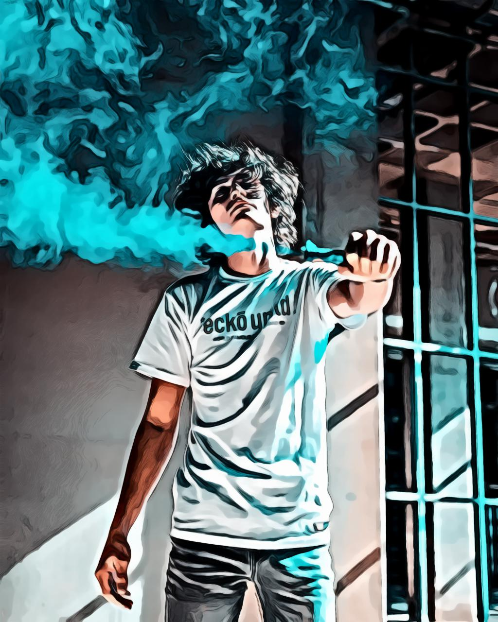 Man posing while holding blue smoke bomb