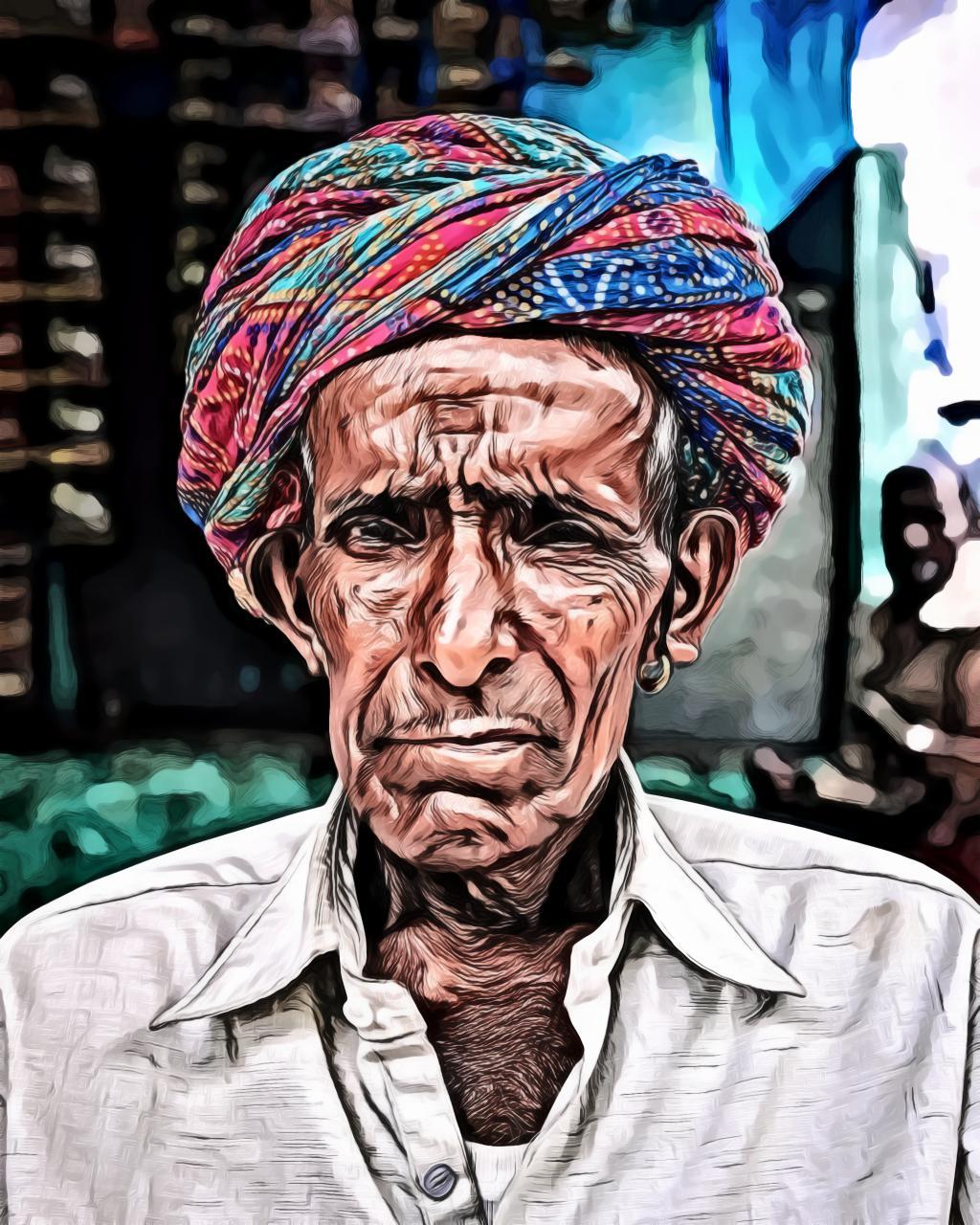 Portrait of an old man wearing headscarf