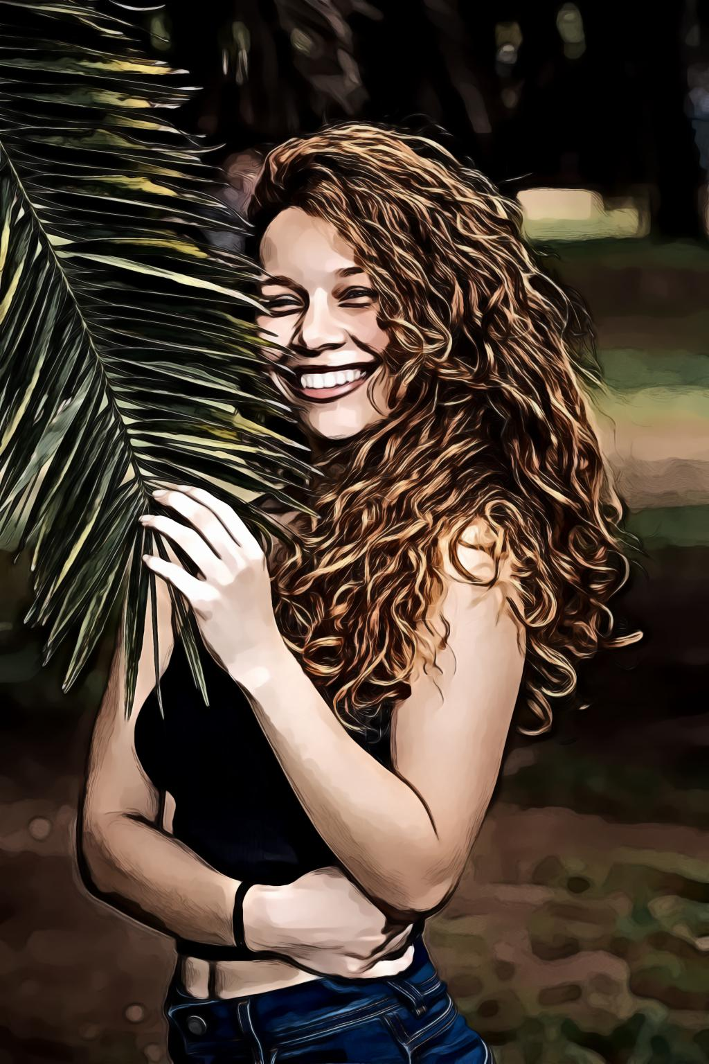 Woman holding green leaf and smiling